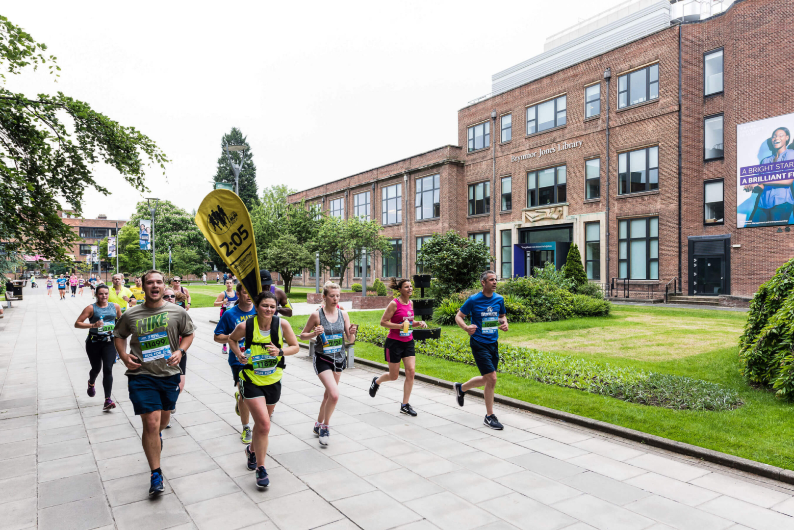 People outside running through the university campus for an event